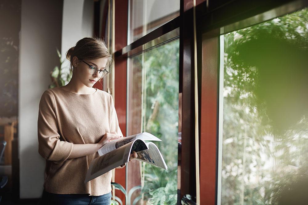 woman-reading-window